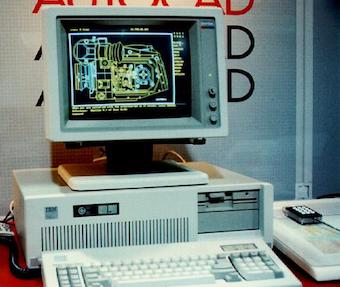 old photo of IBM PC/AT running AutoCAD in front of an AutoCAD poster